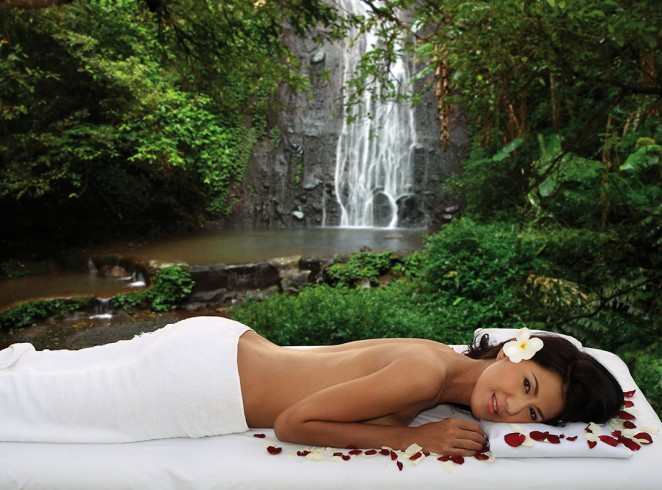 woman during outdoor spa, massage in exotic natural surrounding